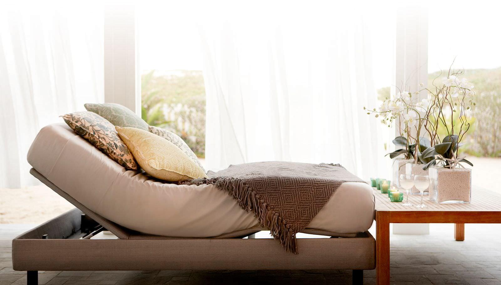 Amerisleep Adjustable Bed sitting in a sunny, bedroom setting.