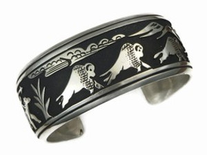 Sterling Silver Large Buffalo Hunt Bracelet by Tommy Singer, Navajo