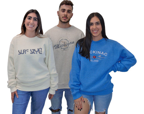 """Shown here from left to right: 4047 Ice Banana with custom embroidery worn by her; 4047 Ice Oatmeal with """"EMB10120"""" embroidery worn by him; and 4047 Denim with """"EMB40621"""" embroidery worn by her. Embroideries are sold separately."""