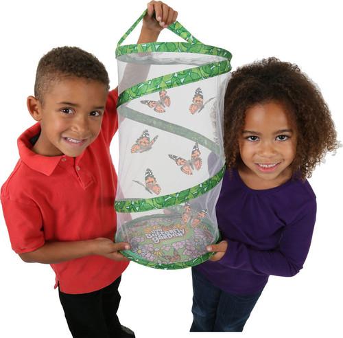kids holding giant butterfly habitat