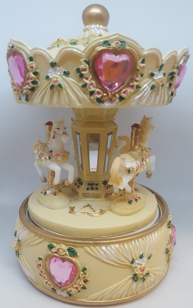 Cotton Candy 3 Horse Carousel 15 cm CAR20 at Baby Barn Discounts Beautiful musical carousel has extremely fine detail and when turned clockwise plays a musical tune.