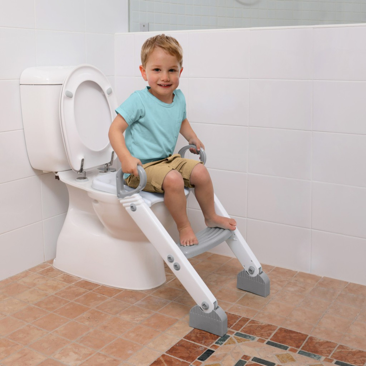 Dreambaby Step-Up Toilet Topper Grey White at Baby Barn Discounts Dreambaby Step-Up Toilet Topper is a toilet trainer that makes toilet training even easier.