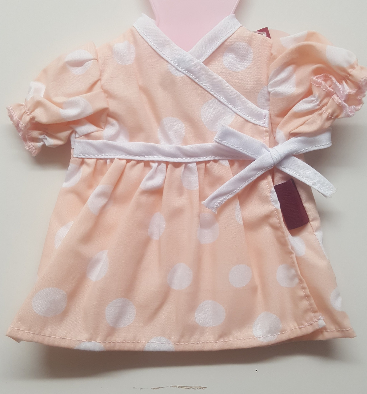 Gotz Coral Pink White Pockadot Dress 30-33cm at Baby Barn Discounts Gotz very sweet coral pink dress has white polkadots and an emperor line bow.
