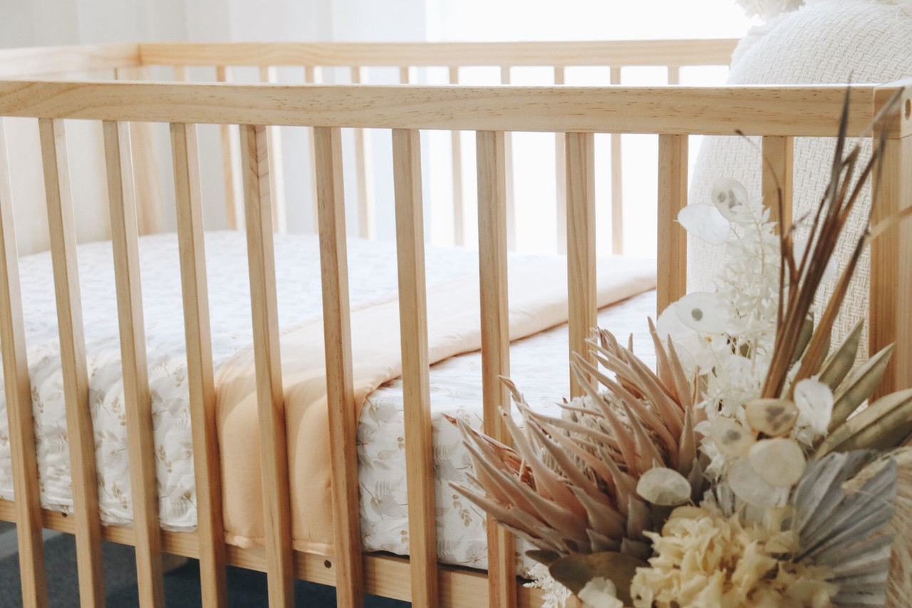 Snuggly Jacks Cotton Cot Quilt | Baby Barn Discounts Snuggly Jacks 100% unbleached cotton batting cot quilt which can breathe and absorb moisture.