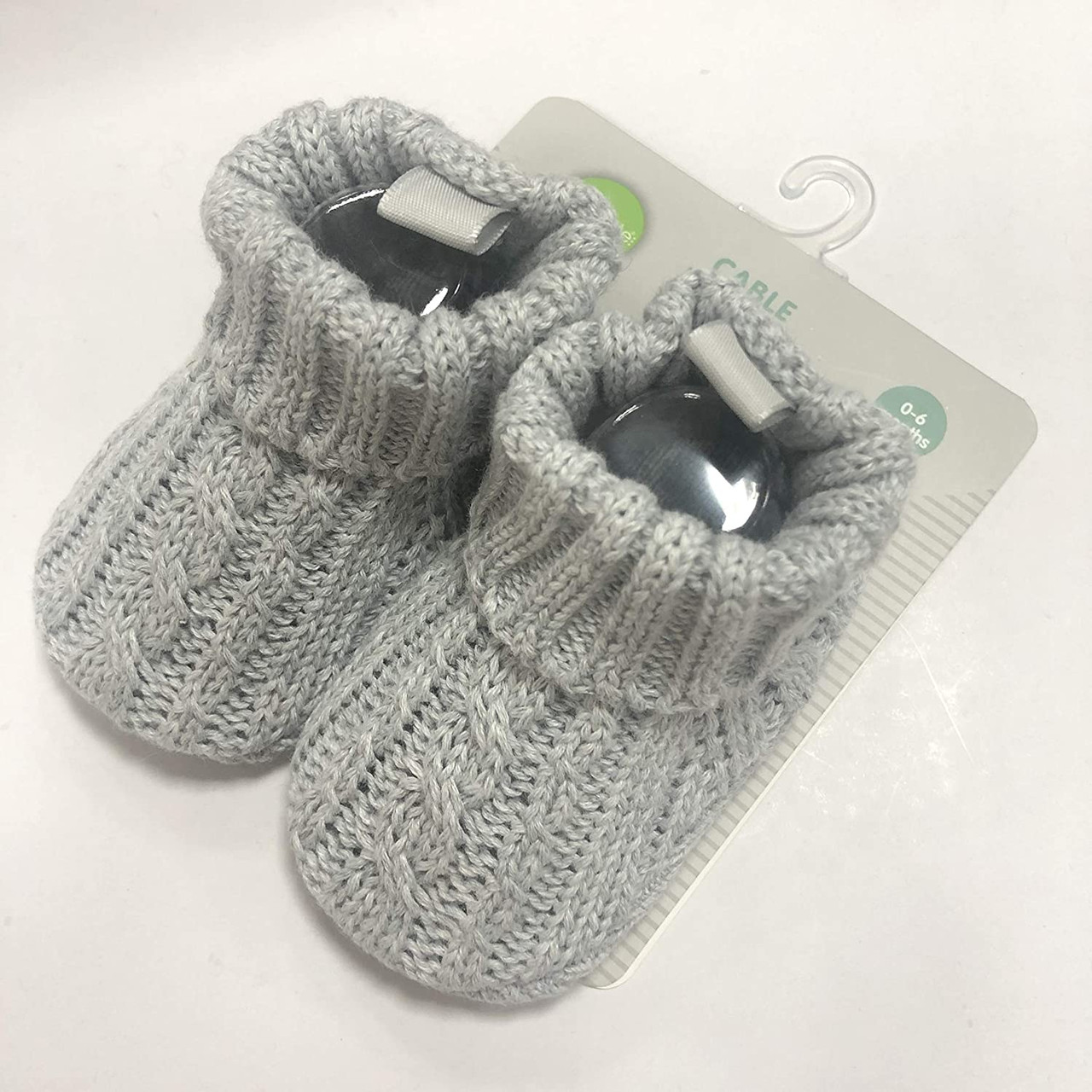 Playette Cable Knitted Bootie 0-6 months at Baby Barn Discounts Keep those tiny toes toasty with these Cable Knit Booties. Super soft and gentle on little feet. In grey or white knit, they match every outfit and are perfect for even the coldest outings.
