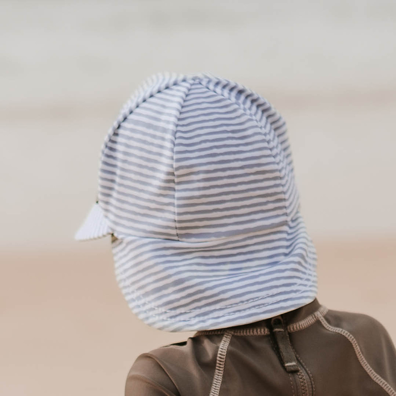 Bedhead Beach Legionnaire Flap Hat - Baby Blue Stripe at Baby Barn Discounts A beautiful nautical stripe that will look fantastic with any beach outfit. The best accessory for fun in the sun.