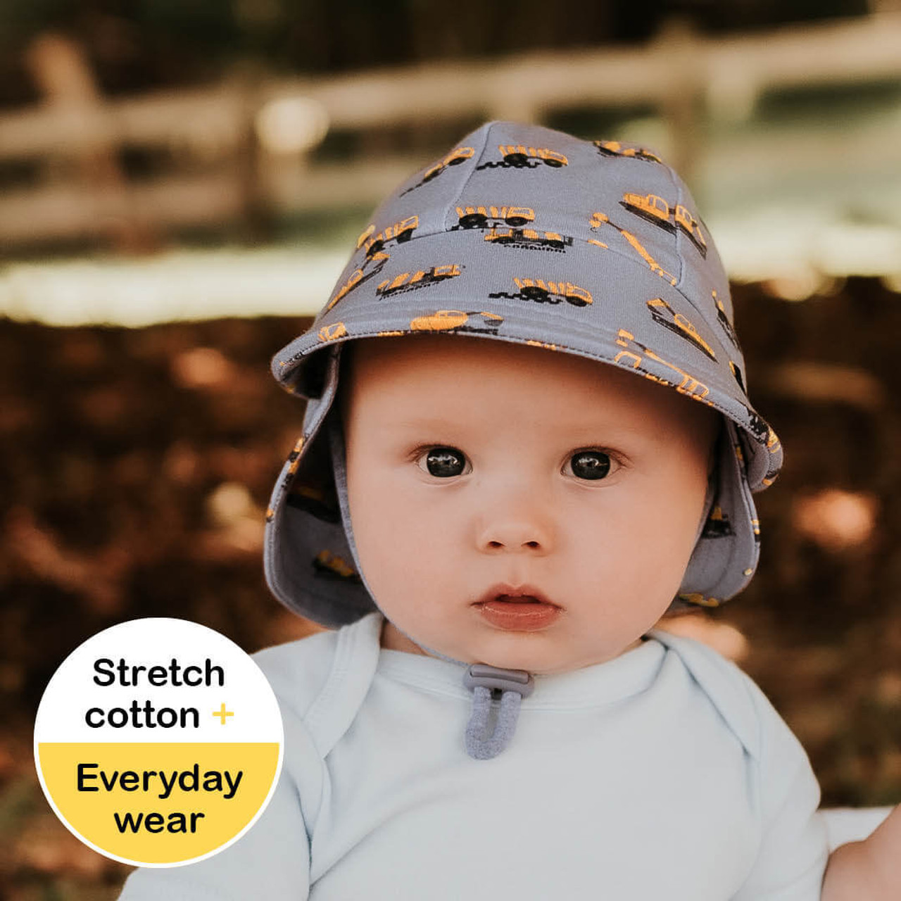 Bedhead Legionnaire Flap Hat - Machinery at Baby Barn Discounts Find us a child who doesn't like diggers, dumpers and mixer trucks! With a neutral grey background and yellow trucks - this is the perfect hat to try out on kids who aren't too keen to keep hats on heads!