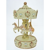Cotton Candy Yellow Carousel 25cm CAR39 at Baby Barn Discounts A beautiful yellow carousel with details of roses and gold trimmings, plays the tune Fur Elise