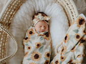 Snuggly Jacks Stretch Wrap Swaddle & Top Knot Set   Baby Barn Discounts Snuggly Jacks stretch swaddle is perfect for getting a nice tight fit, while still being breathable.