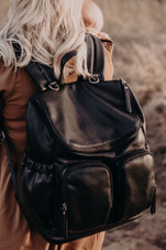 OiOi Faux Leather Nappy Backpack at Baby Barn Discounts Oioi stunning nappy bag has loads of handy pockets designed to carry all of those baby necessities and includes a cushioned changing mat, insulated bag for babys bottle and a zip top purse for any soiled items.