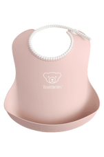 Baby Bjorn Soft Bib Powder Pink at Baby Barn Discounts Baby Bjorn's  soft and comfortable plastic bib catches the food that misses your child's mouth.