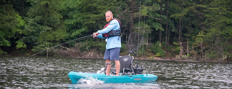 Man standing on a Jackson Kayak Big Rig FD