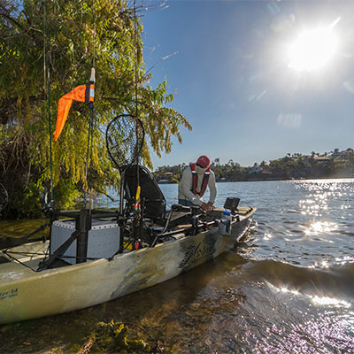 Guy getting ready to go fishing in his Hobie kayak.
