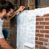 Application of Block & Wall™ Liquid Rubber on interior brick wall