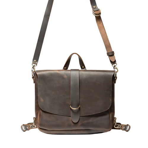 This leather messenger backpack in dark brown  is showing the view from the front