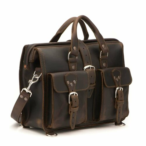 This dark brown leather briefcase is standing at an angle and has two pockets on the front with three buckles.