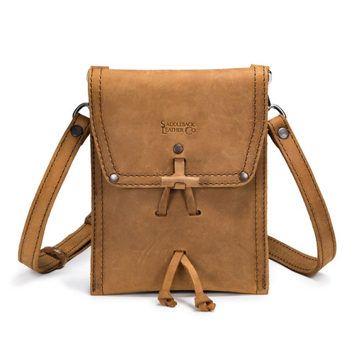 This is a tan brown leather satchel that is thin from the front.