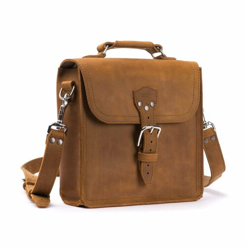 This is a tan brown leather satchel man bag from the side.