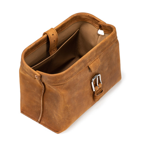 This is a tan brown leather toiletry bag on the top side.