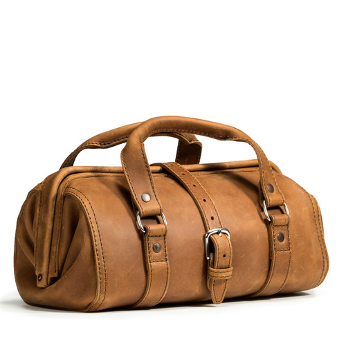 This tan brown leather doctor's leather tool bag is angled.