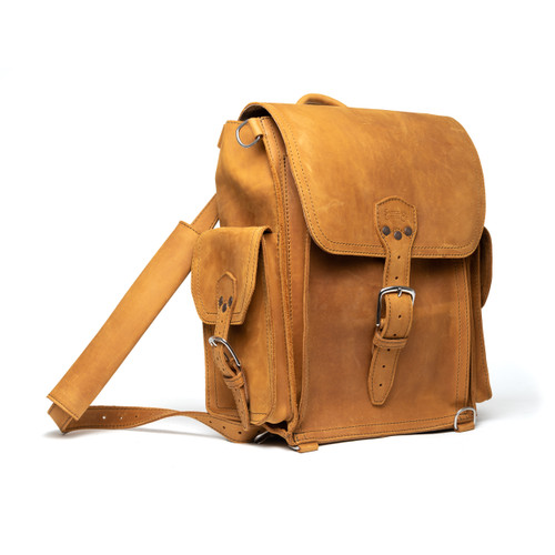 This is a tan brown leather backpack from the side view.