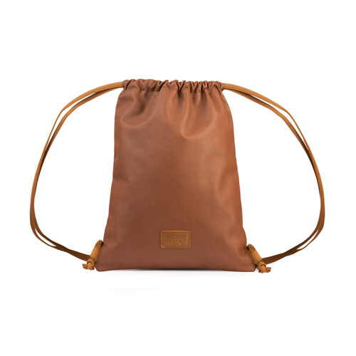 This red brown leather backpack is closed at the top.