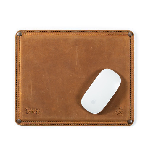 This is a tan brown leather mouse pad with a mouse on it. It has stitching around the edges and neoprene in the middle.