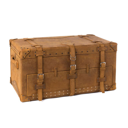 This is a leather trunk that will be a vintage antique one day in a museum. This is the front angled side. It is a tan brown steamer trunk that was old time luggage back in the day on trains and ships.