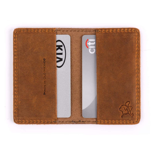 This is the interior of a tan brown leather business card holder wallet.
