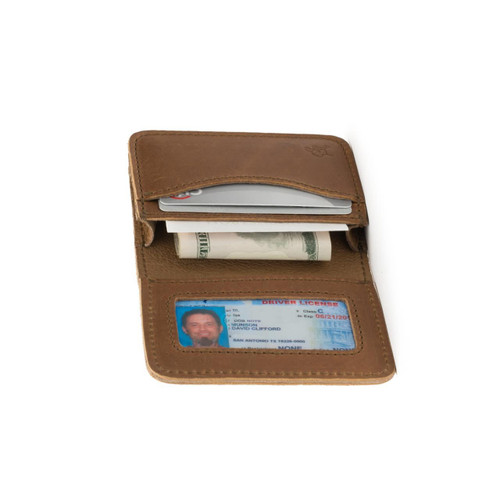 This is a tan brown leather business card holder wallet laying flat and open.