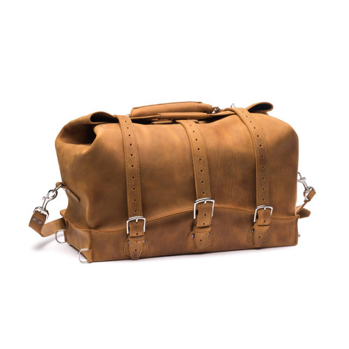 This is a tan brown leather duffle bag with three straps on front to hold overnight travel gear.