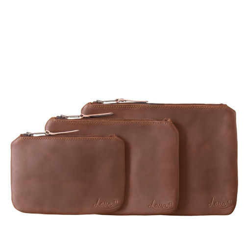 This is the chestnut view of the set of three leather pouches