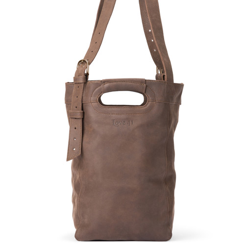 This women's leather tote in dark brown is showing the front view