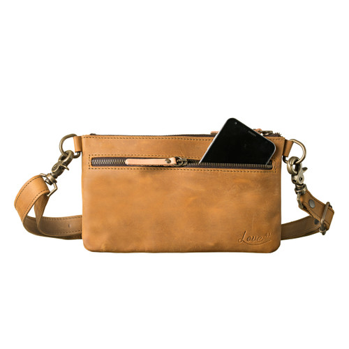 This light tan colored leather belt bag is showing the front view