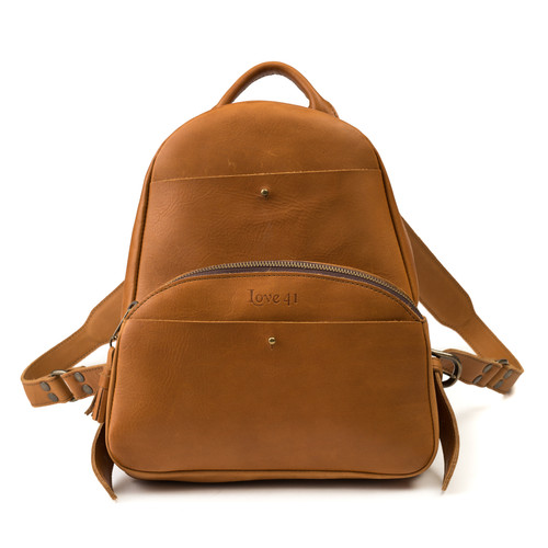 This is a tan brown women's leather backpack from the front side.