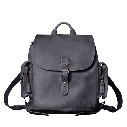 This black women's brown leather backpack is facing forward.