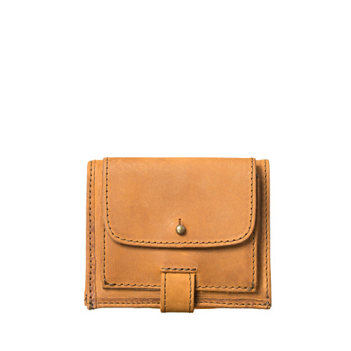 This is a tan brown leather wallet that is called a bifold because it holds cards and cash and folds in the middle. This one is closed.