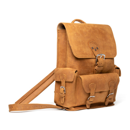 This is an image of a tan brown leather backpack on the front side. It is a three pocket backpack made of full grain leather for men and women.