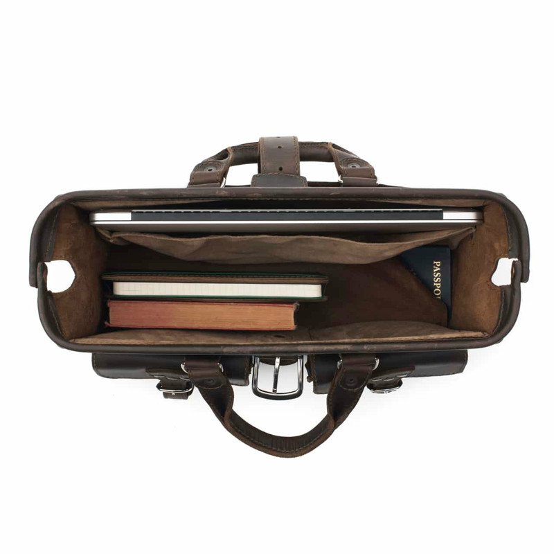This is a dark brown leather briefcase from above with the mouth wide open.