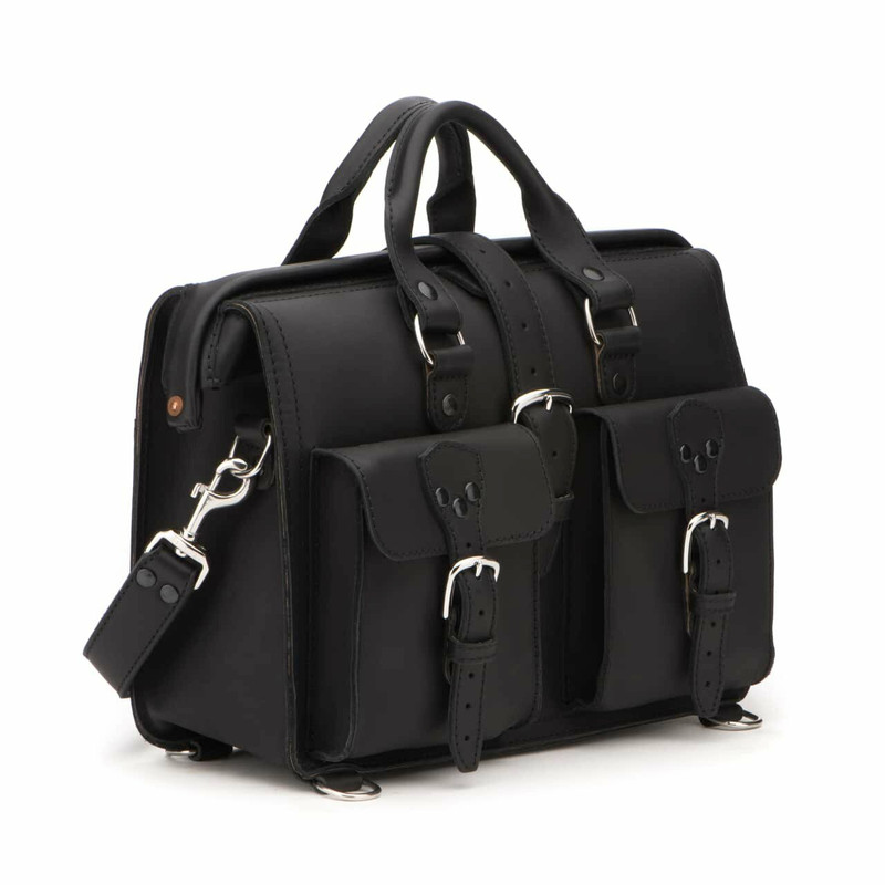 This black leather briefcase is angled to the side and has two pockets on the front with handles going straight into the air.