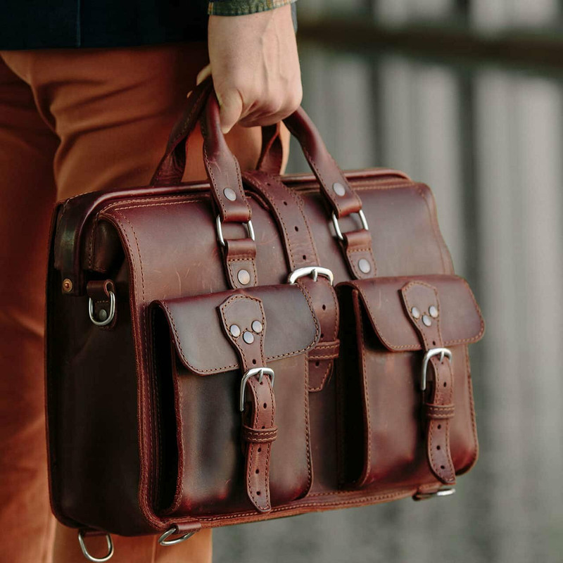 This is a red brown leather briefcase with the gladstone bag closure.