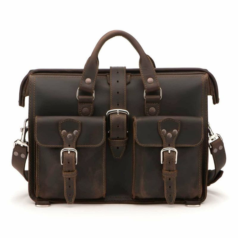 This is a picture of a dark brown leather briefcase staring straight into the camera. Not even blinking.