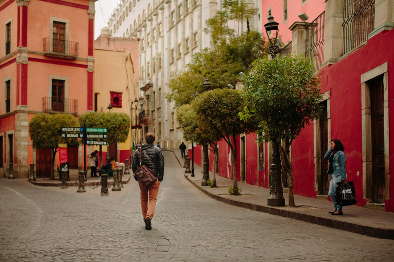 This is Joe carrying the red brown leather briefcase in Guanajuato.