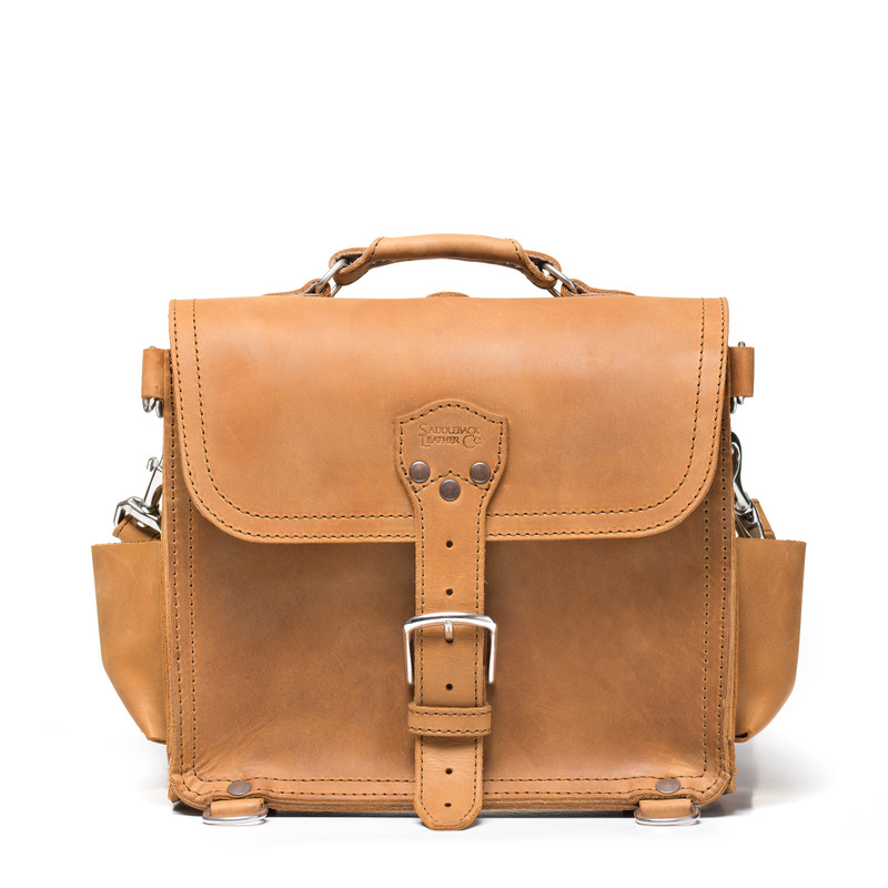 This is the front view of a tan brown rounded leather satchel.