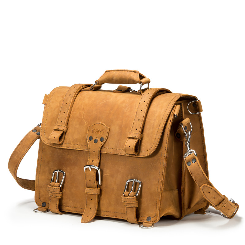 This light tan brown leather briefcase has a belt strap on each side.