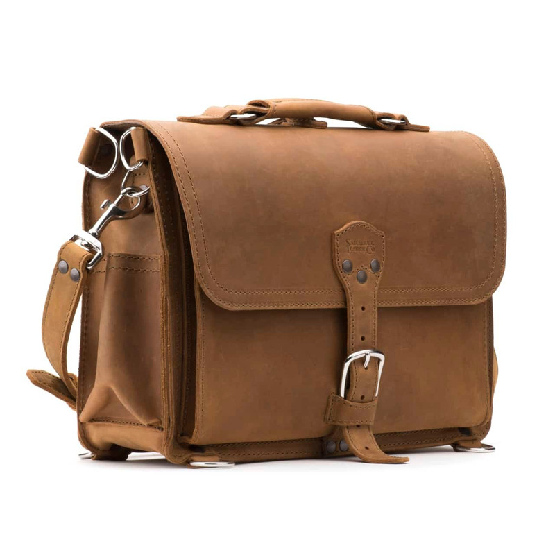 This is a tan brown leather briefcase with a flap over the front.