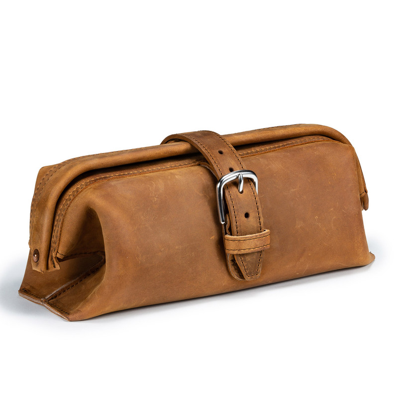 This is a tan brown leather toiletry bag from the front angle.