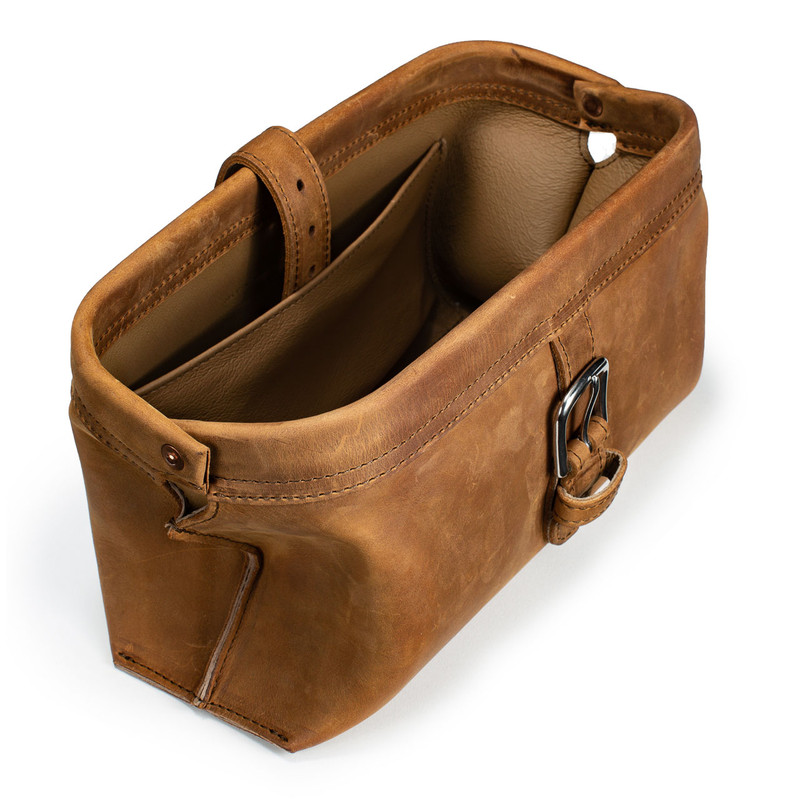 This is a tan brown leather toiletry bag from the top angled.