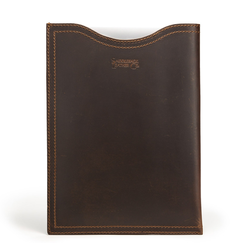 This is the front of a dark brown vertical leather laptop sleeve made of one piece of leather.