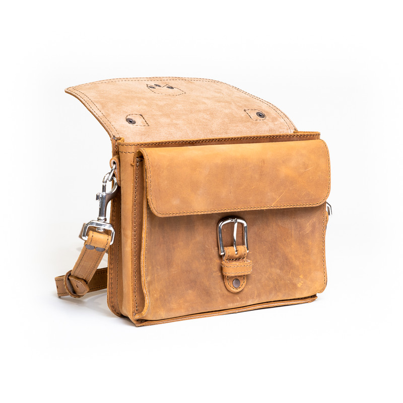 This is the front side of a tan brown leather satchel with a front pocket showing.